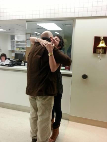 Dad hugs post-bell-ringing